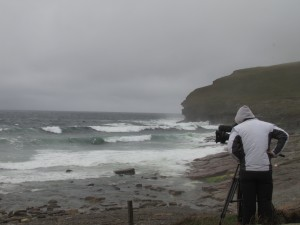 Cameraman for BBC Breakfast News filming waves at Billia Croo, EMEC's wave test site