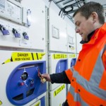 EMEC Electrical and Test Engineer working on switch gear inside the Billia Croo substation (Image Global Warming Images)