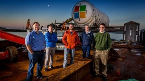 Microsoft's Project Natick team gathers on a barge tied up to a dock in Scotland's Orkney Islands in preparation to deploy the Northern Isles datacenter on the seafloor. Pictured from left to right are Mike Shepperd, senior R&D engineer, Sam Ogden, senior software engineer, Spencer Fowers, senior member of technical staff, Eric Peterson, researcher, and Ben Cutler, project manager. Photo by Scott Eklund/Red Box Pictures.