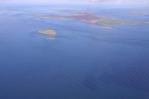 Aerial view of tide flowing through EMEC Fall of Warness tidal test site (Credit Aquatera)